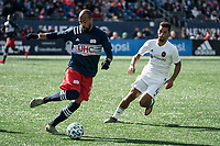 FOXBOROUGH, MA - MARCH 7: Teal Bunbury #10 of New England Revolution passes under pressure from Johan Kappelhof #4 of Chicago Fire during a game between Chicago Fire and New England Revolution at Gillette Stadium on March 7, 2020 in Foxborough, Massachusetts.