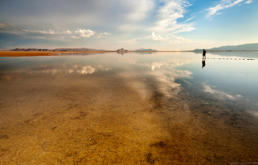 Photographer Greg Martin wades out into an ephemeral lake in the Black Rock Desert of Nevada.