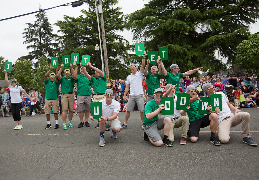 """Pest extermination company representatives spell out """"I won't let you down"""" as they dance through the streets in the Fourth of July Parade in Ridgefield Monday July 4, 2016. (Photo by Natalie Behring/ for the The Columbian)"""
