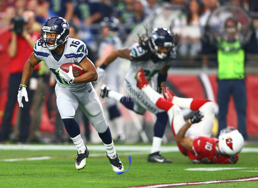 Jan 3, 2016; Glendale, AZ, USA; Seattle Seahawks wide receiver Tyler Lockett (16) returns a kick off in the first quarter against the Arizona Cardinals at University of Phoenix Stadium. Mandatory Credit: Mark J. Rebilas-USA TODAY Sports
