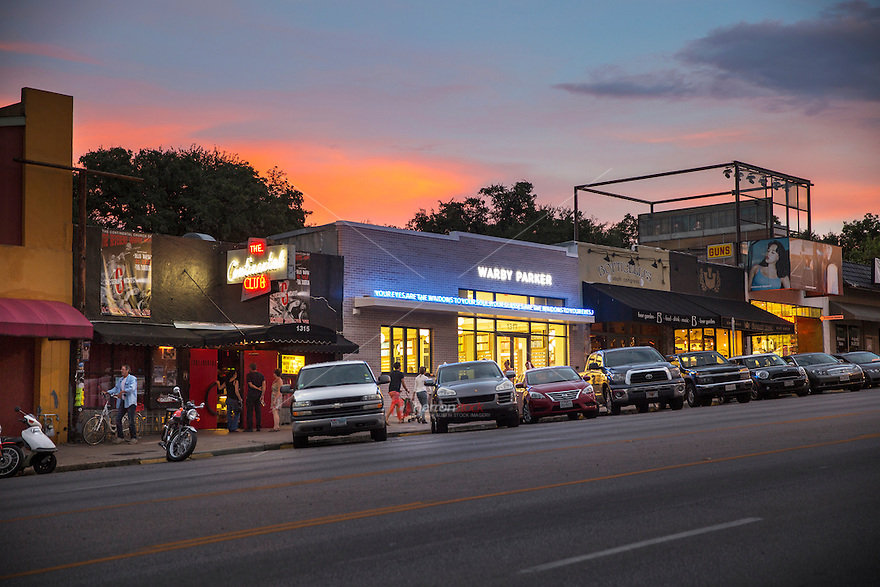 Sunset falls on South Congress Avenue, a popular shopping and live music district in downtown Austin, Texas - Stock Image.