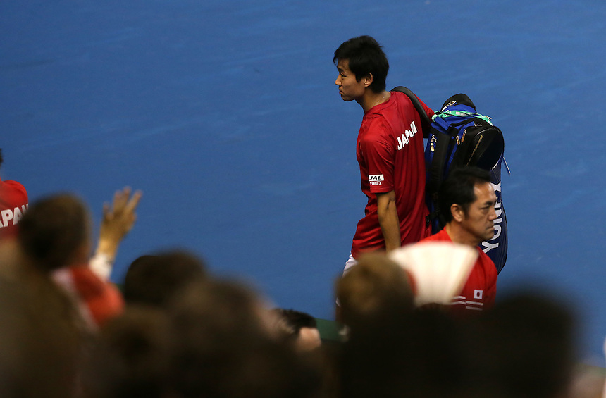 Yoshihito Nishioka leaves the court after he and  partner Yasutaka Uchiyama lose their doubles rubber against Andy Murray and Jamie Murray today - Andy Murray and Jamie Murray (GBR) def Yoshihito Nishioka and Yasutaka Uchiyama (JPN) 6-3 6-2 6-4<br /> <br /> Photographer Stephen White/CameraSport<br /> <br /> International Tennis - 2016 Davis Cup by BNP Paribas - World Group First Round - Great Britain v Japan - Day 2 - Saturday 5th March 2016 - Barclaycard Arena, Birmingham, Great Britain<br /> <br /> &copy; CameraSport - 43 Linden Ave. Countesthorpe. Leicester. England. LE8 5PG - Tel: +44 (0) 116 277 4147 - admin@camerasport.com - www.camerasport.com.