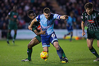 Yann Songo'o of Plymouth Argyle holds back Matthew Bloomfield of Wycombe Wanderers during the Sky Bet League 2 match between Plymouth Argyle and Wycombe Wanderers at Home Park, Plymouth, England on 26 December 2016. Photo by Mark  Hawkins / PRiME Media Images.