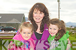 CHEERING ON DADDY: Blathin and Muireann McBride with their mother Michelle cheering on their Dad, Dave at the7 Frogs Triathlon in the Maharees on Saturday.