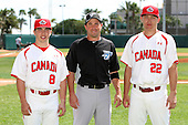 Toronto Blue Jays John McDonald #6 poses with a photo with Team Canada's 17u team members Kyle Hann #8 and Justin Atkinson #22 before an exhibition game vs. Team Canada at Al Lang Field in St. Petersburg, Florida;  March 4, 2011.  Toronto defeated Team Canada 9-0.  Photo By Mike Janes/Four Seam Images