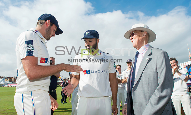 Picture by Allan McKenzie/SWpix.com - 23/08/2016 - Cricket - Specsavers County Championship - Yorkshire County Cricket Club v Nottinghamshire County Cricket Club - North Marine Road, Scarborough, England - Yorkshire President John Hampshire presents county caps to Azeem Rafiq & Jack Leaning.