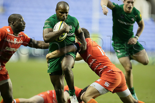 01.11.2014.  Reading, England.  LV Cup Rugby. London Irish versus Leicester Tigers. Topsy Ojo is tackled by Javieh Pohe (r) and Miles Bejamin.