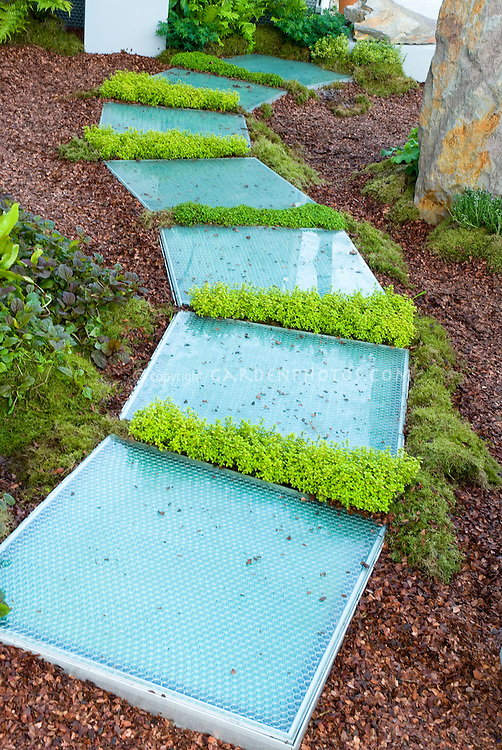 how to keep grass from growing through my mulch