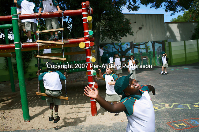 CAMPS BAY, SOUTH AFRICA January 17: Children play in the schoolyard as they attend Grade 1 first day of school at Camps Bay Preparatory School on January 17, 2007 in Camps Bay, an affluent suburb of Cape Town, South Africa. The seaside suburb is one of the most affluent in the country and the school has a good record racial mix..(Photo by Per-Anders Pettersson/Getty Images)..