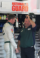 Oct 3, 2008; Talladega, AL, USA; NASCAR Sprint Cup Series driver Dale Earnhardt Jr (left) talks to crew chief Tony Eury Jr during practice for the Amp Energy 500 at the Talladega Superspeedway. Mandatory Credit: Mark J. Rebilas-