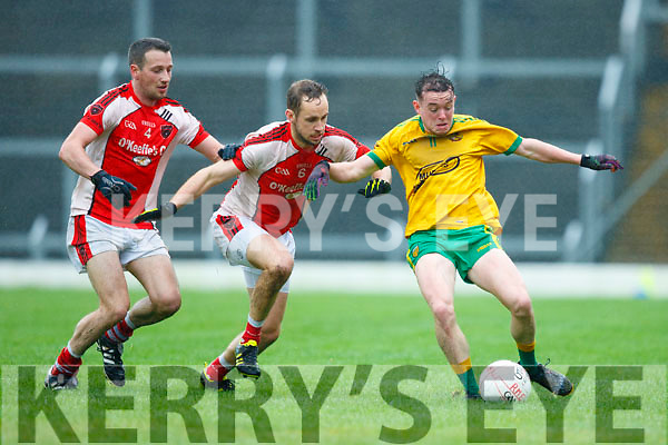 Gneeveguilla's Padraig Doyle, slips this pass away before Rathmore's Conor O'Sullivan can block in their O'Donoghue Cup Semi-final meeting in Fitzgerald stadium on Saturday.