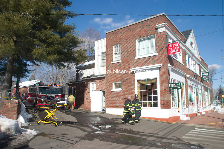 CHESHIRE CT.-10 FEBRUARY  2011 021011DA01-  A fire that started in the ventilation system spread to the attic over the kitchen of Grand Apizza in Cheshire Thursday morning.<br /> Darlene Douty Republican American