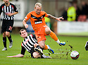 PARS PATRICK BOYLE CHALLENGES DUNDEE UTD'S JOHNNY RUSSELL