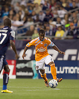 Houston Dynamo midfielder Corey Ashe (26) brings the ball forward. The New England Revolution defeated Houston Dynamo, 1-0, at Gillette Stadium on August 14, 2010.