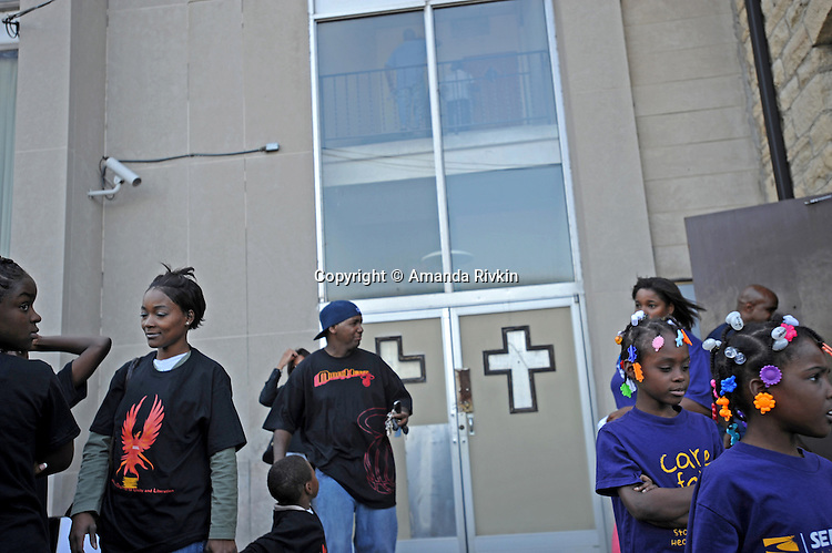 Protesters gather outside the Olivet Baptist Church before a protest organized by Communities for an Equitable Olympics 2016, an umbrella group comprised of various community organizations, at Martin Luther King Drive and 31st Street in Chicago, Illinois on August 14, 2008. Chicago is currently bidding for the 2016 Olympics; organizers question the long-term economic benefits to the communities effected by the construction of the Olympic village and the city's financial resources.