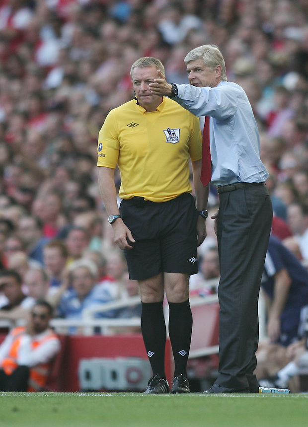 Arsenal's Manager Arsene Wenger complains to the referee..Football - Barclays Premiership - Arsenal v Sunderland - Saturday 18th August 2012 - The Emirates Stadium - London..