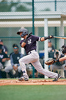 GCL Yankees East third baseman Asdrubal Alvarez (1) hits an RBI single during the second game of a doubleheader against the GCL Pirates on July 31, 2018 at Pirate City Complex in Bradenton, Florida.  GCL Pirates defeated GCL Yankees East 12-4.  (Mike Janes/Four Seam Images)