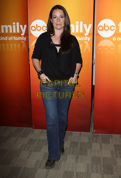 HOLLY MARIE COMBS.Disney/ABC Television Group Press Junket held At The ABC Television Network Building, Burbank, California, USA..May 15th, 2010.full length jeans denim black shirt top.CAP/ADM/KB.©Kevan Brooks/AdMedia/Capital Pictures.
