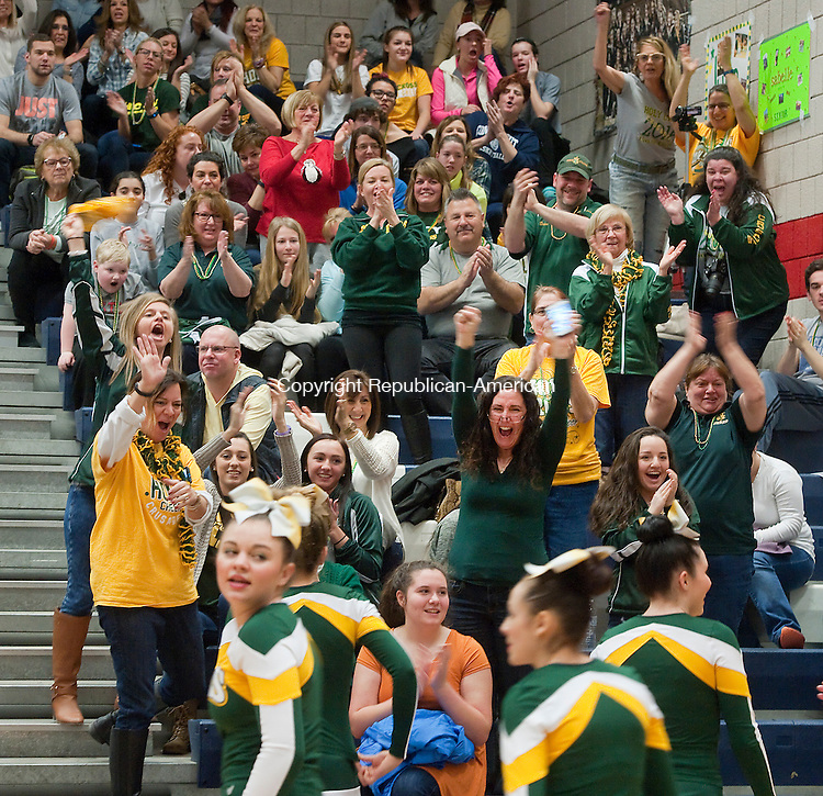 WATERBURY CT--- -022016JS04- Parents and supporters cheer as the Holy Cross High School cheerleading team make their way past during the NVL Cheerleading Championships held Saturday at Crosby High School in Waterbury. <br />   Jim Shannon Republican-American