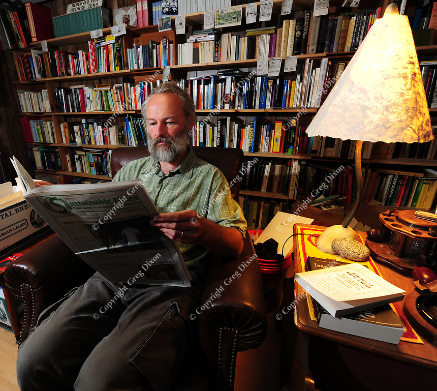 George Zens' office is lined with research materials that he uses to publish the Sustainable Times. He relaxes here ion Saturday, August 16, 2008 at his home office in Middleton, Wisconsin.