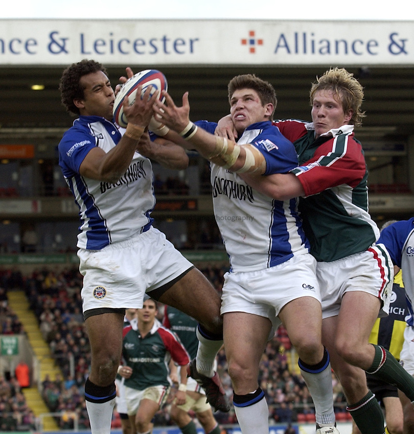 Photo. Henry Browne. Leicester v Bath. Zurich Premiership. 09/10/2004..Andrew Higgins, Michael Lipman and Ollie Smith go for the ball.