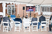 People sit in the overflow area and watch as Democratic presidential candidate and former Vice President Joe Biden speaks at a campaign event at the Governor's Inn and Restaurant in Rochester, New Hampshire, on Wed., October 9, 2019. At this event, Biden said for the first time that he supported the impeachment inquiry against current President Donald Trump.