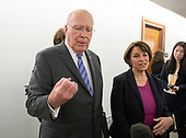 United States Senator Patrick Leahy (Democrat of Vermont) and  US Senator Amy Klobuchar (Democrat of Minnesota), right, respond to reporter's questions in the hallway during a break in the testimony of Dr. Christine Blasey Ford  before the US Senate Committee on the Judiciary on the nomination of Judge Brett Kavanaugh to be Associate Justice of the US Supreme Court to replace the retiring Justice Anthony Kennedy on Capitol Hill in Washington, DC on Thursday, September 27, 2018.   <br /> Credit: Ron Sachs / CNP<br /> (RESTRICTION: NO New York or New Jersey Newspapers or newspapers within a 75 mile radius of New York City)