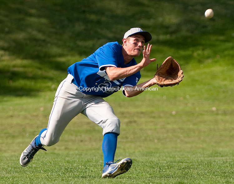 WINSTED, CT--051115JS06- Lewis Mills' Grant McGregor (25) runs down a fly-ball during their game against Northwestern Monday at Northwestern Regional High School in Winsted.<br /> Jim Shannon Republican-American