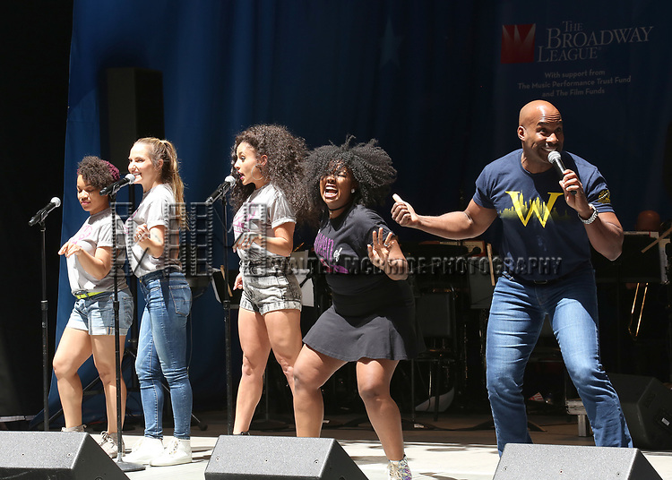 Alan H. Green and Trista Dollison with the cast of 'Charlie and the Chocolate Factory' on stage at United Airlines Presents #StarsInTheAlley free outdoor concert in Shubert Alley on 6/2/2017 in New York City.