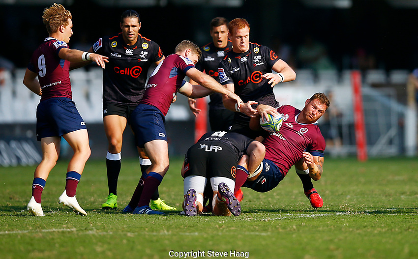 DURBAN, SOUTH AFRICA - APRIL 19: Daniel Du Preez of the Cell C Sharks tackling Scott Higginbotham of The St.George Queensland Reds during the Super Rugby match between Cell C Sharks and Reds at Jonsson Kings Park Stadium on April 19, 2019 in Durban, South Africa. Photo: Steve Haag / stevehaagsports.com