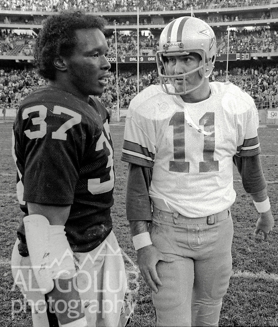 Oakland Raiders vs Dallas Cowboys at Oakland-Alameda County Coliseum Sunday, December 7, 1980. After the game Oakland Defensive Back Lester Hayes (37) and Cowboys quarterback Danny White (11) .Raiders lost to the Cowboys 13 -19, but they did will the Superbowl in post season.