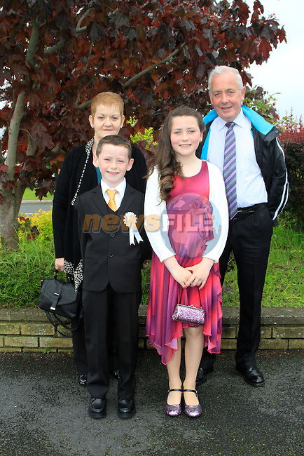 Adam Everitt with sister Kayleigh and Ann and Eamon Johnson during the 1st Communion at Ballsgrove church on Sunday 25th March 2014.<br /> Picture:  Thos Caffrey / www.newsfile.ie