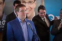 PQ Leadership candidate Pierre-Karl Peladeau touches PQ candidate for the riding of Jean-Talon Clement Laberge during the presentation of parti Quebecois candidates for the upcoming byelection Tuesday May 5, 2015.