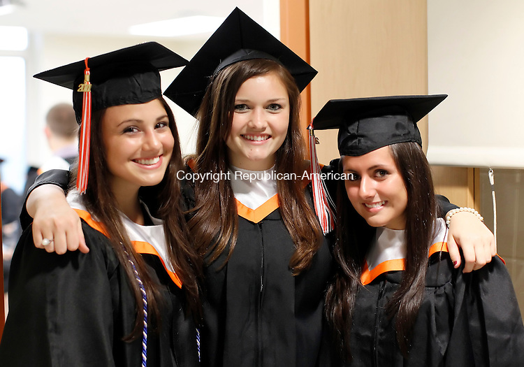 Watertown, CT- 17, April 2011-061711CM06 L-R Brianna Daley, Megan Downey and Kaitlin Crane smile for a photo before the start of Watertown High School's commencement exercises Friday night.   Christopher Massa Republican-American