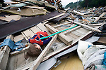 A doll lies among the debris in Otsuchi, Iwate Prefecture, Japan on 11 June, 2011, 3 months after the magnitude 9 quake and tsunamis hit the northeast coast. Authorities are unable to dispose of much of the debris created by the March disasters due to fears of radiation contamination, leading to giant mounds of waste that are becoming increasingly more toxic. The disaster is estimated to have left behind some 25 million tons of waste. Photographer: Robert Gilhooly