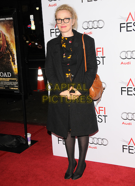 "JULIE DELPY.arriving at AFI Fest's Gala Screening of ""The Road"" at Grauman's Chinese Theatre in Hollywood, California.  November 4th 2009..full length geek glasses black frames yellow print dress coat tights  shoes  brown leather shoulder bag .CAP/RKE/DVS.©DVS/RockinExposures/Capital Pictures."