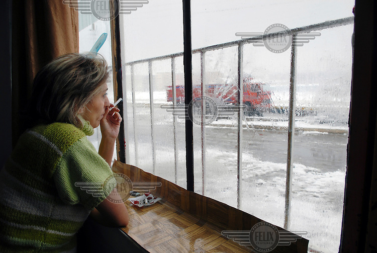 38 year old Sister Eti smokes as she looks out at the winter weather outside her window. Eti is an Iranian refugee. She moved to Turkey because she wanted to become a Christian. Eti says under Islamic law in Iran she would be put to death if she did this. Eti hopes by telling her story she and other women in her situation will be helped.