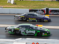 Sep 25, 2016; Madison, IL, USA; NHRA pro stock driver Alex Laughlin (near) races alongside Vincent Nobile during the Midwest Nationals at Gateway Motorsports Park. Mandatory Credit: Mark J. Rebilas-USA TODAY Sports