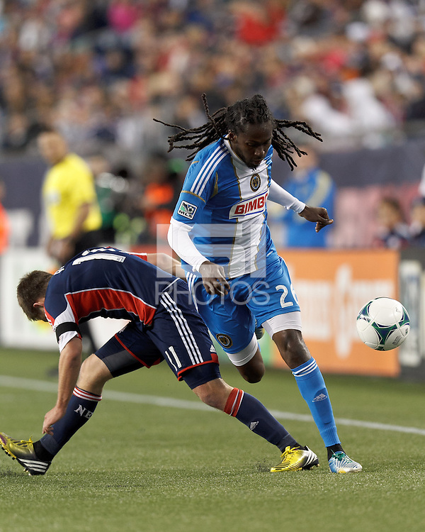 New England Revolution midfielder Kelyn Rowe (11) disrupts Philadelphia Union midfielder Keon Daniel (26) dribble.In a Major League Soccer (MLS) match, the New England Revolution (blue/red) defeated Philadelphia Union (blue/white), 2-0, at Gillette Stadium on April 27, 2013.