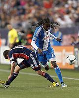 New England Revolution midfielder Kelyn Rowe (11) disrupts Philadelphia Union midfielder Keon Daniel (26) dribble.In a Major League Soccer (MLS) match, the New England Revolution (blue/red) defeated Philadelphia Union (blue/white), 2-0, at Gillette Stadium on April 27, 2013.