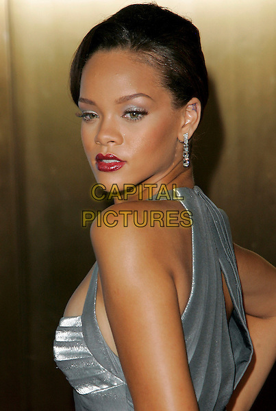 RIHANNA .Arrivals at the Conde Nast Media Group's Third Annual Fashion Rocks Concert, held at Radio City Music Hall, .New York City, NY, USA,7 September 2006..portrait headshot red lipstick earrings full length grey silver dress striped stripes looking back over shoulder.Ref: ADM/JL.www.capitalpictures.com.sales@capitalpictures.com.©Jackson Lee/AdMedia/Capital Pictures.