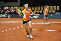 13 April, 2016, France, Trélazé, Arena Loire,   Semifinal FedCup, France-Netherlands, Dutch team practise, doubles Kiki Bertens (L) and Richel Hogenkamp<br /> Photo: Henk Koster/tennisimages