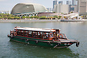 A tour boat on Singapore River in front of Esplanade - Theatres on the Bay (aka 'The Durian') in Singapore
