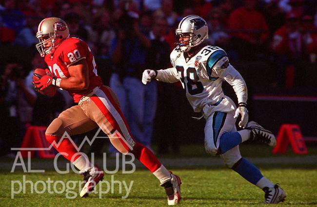San Francisco 49ers vs. Carolina Panthers at Candlestick Park Sunday, November 5, 1995.  Panthers beat 49ers  13-7.  Carolina Panthers defensive back Tyrone Poole (38) pursues San Francisco 49ers running back Derek Loville (20).