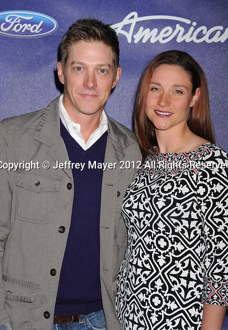 LOS ANGELES, CA - MARCH 01: Kevin Rahm and fiancee Amy arrive at the American Idol Finalists party at The Grove Parking Structure Rooftop on March 1, 2012 in Los Angeles, California.