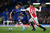 Willian of Chelsea takes the ball past Nicolas Tagliafico of Ajax during Chelsea vs AFC Ajax, UEFA Champions League Football at Stamford Bridge on 5th November 2019