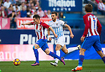 Kevin Gameiro (l) of Club Atletico de Madrid fights for the ball with Ignacio Camacho Barnola of Malaga CF during their La Liga match between Club Atletico de Madrid and Malaga CF at the Estadio Vicente Calderón on 29 October 2016 in Madrid, Spain. Photo by Diego Gonzalez Souto / Power Sport Images