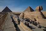 Tourists gather around the Sphinx at the Pyramids of Giza near Cairo, Egypt.