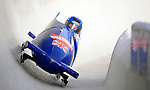 15 December 2007: Great Britain 2 pilot Martin Wright with brakeman Keith McLaughlin exit a turn during their first run at the FIBT World Cup Bobsled Competition at the Olympic Sports Complex on Mount Van Hoevenberg, at Lake Placid, New York, USA. ..Mandatory Photo Credit: Ed Wolfstein Photo