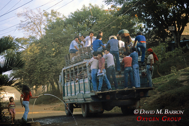 Bus With People On Back and Roof